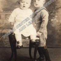 Boy and Baby Posing for Photo