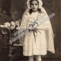 Girl Posing for First Communion Photo